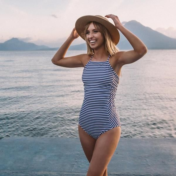 "Quite possibly the most perfect suit known to woman. The perfect combination of classic sophistication (cue the 1/4"" navy nautical stripes) paired with boho-vibes (enter criss-crossing spaghetti strap"