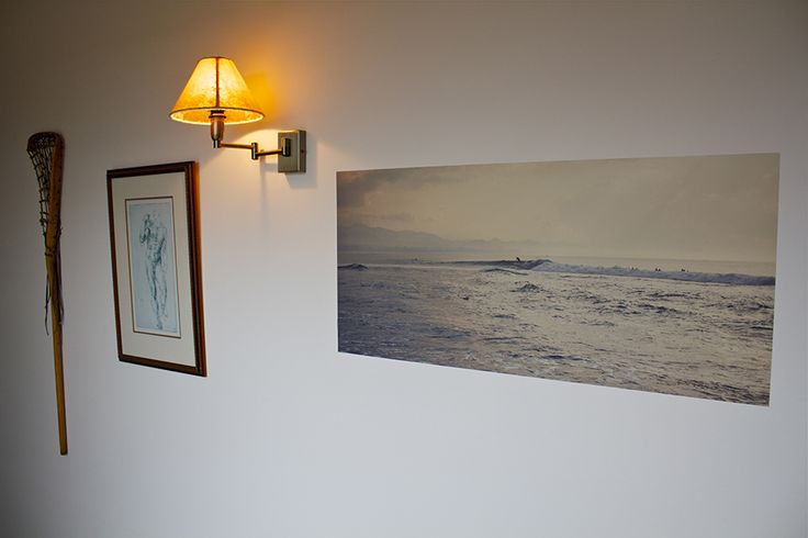 """A decal of a surfer, hanging on a farm wall.  The photo's called """"Cucukan Morning"""", shot in Bali by the lovely Amanda Fordyce."""