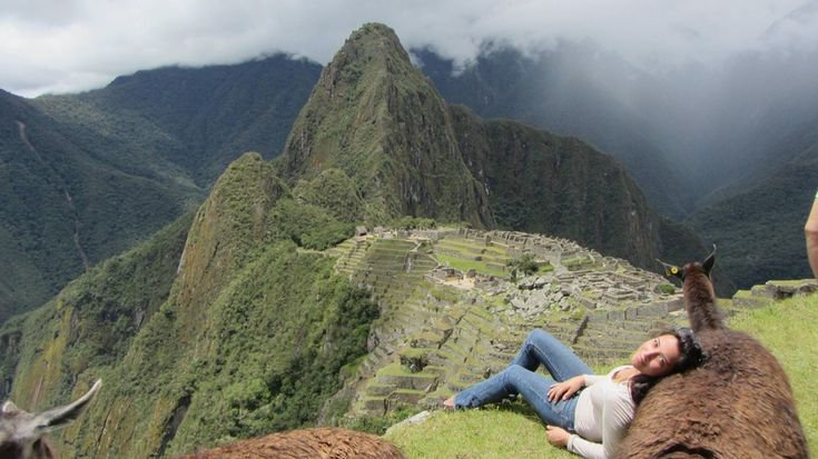 Against a llama in Machu Picchu.   30 Places You'd Rather Be Sitting Right Now