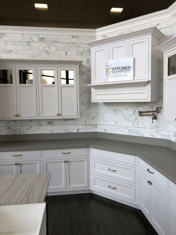Calacatta Oro honed marble backsplash. 3 x 12 subway tiles