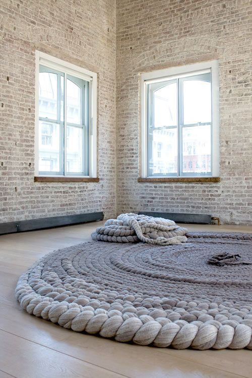 Textile designer & Artist Dana Barnes: GRAZED Amorphous Braided Rug and KNOLL Braided Pouf on display at Ralph Pucci, New York.