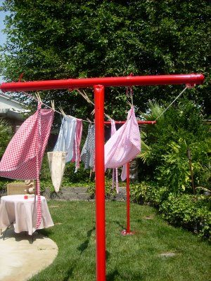 Our clothesline kind of looked like this but it was all rusted.  I would swing around the pole and one day the whole thing came crashing down - time for a clothes dryer!