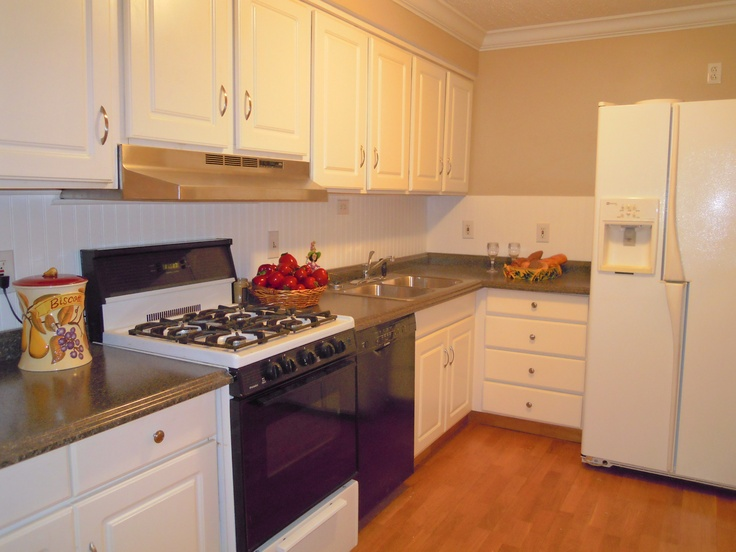 stove, bosch dishwasher and updated cabinets, flooring and countertop ...