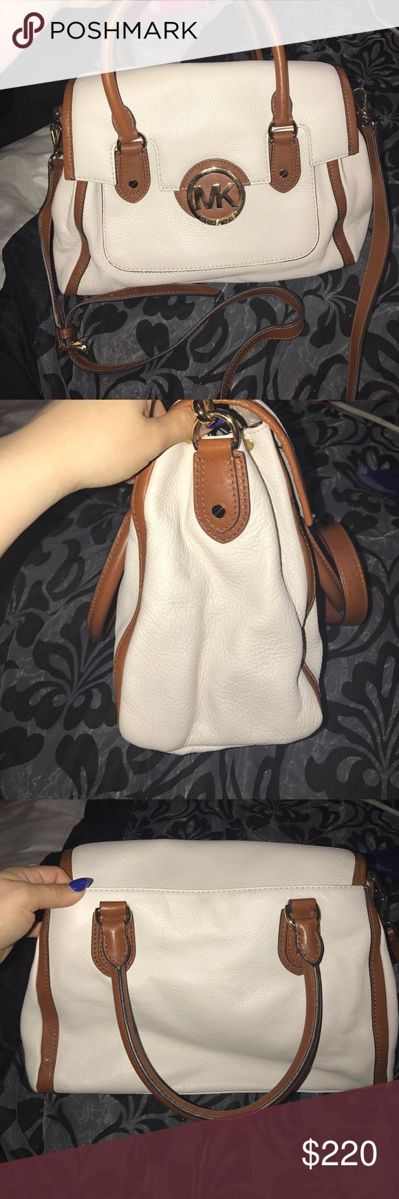 Leather Michael Kors purse Vanilla and tan leather Michael kors satchel. Only used it once it's in perfect condition , tags are still in bag. Michael Kors Bags Satchels