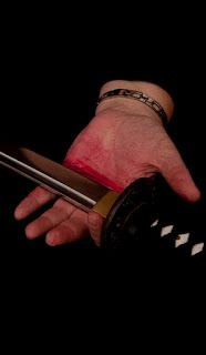 hand holding sword blade, fake blood on palm, #AtoZChallenge 2017, W is for weapon