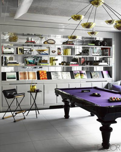 With the gut renovation of a storied Manhattan townhouse, architectural firm Leroy Street Studio and designer James Aman devise a new ideal of urban family life—one that is as glamorous as it is kid-friendly. The billiards room is just one example of how the combined style and substance.  See the rest of the home.    - ELLEDecor.com