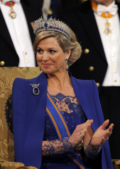 Queen Maxima | The Royal Hats Blog-Queen Maxima wearing a blue gown with flesh colored sleeves and blue lace cuffs to match her gown