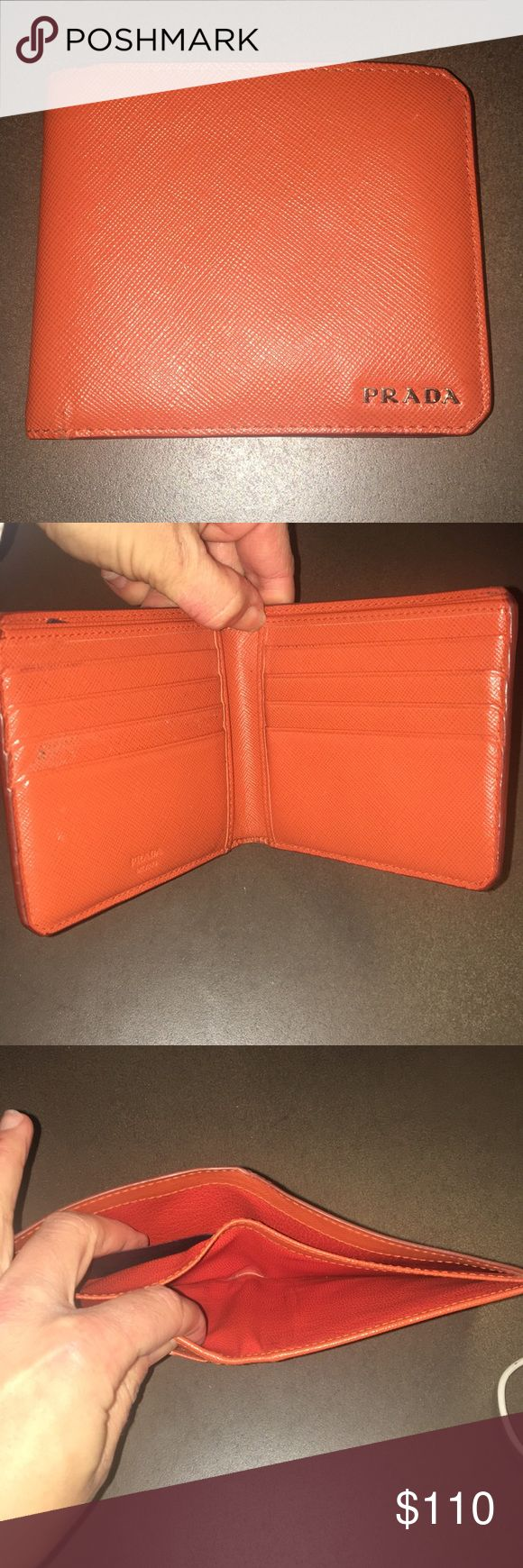 "Men's orange leather Prada wallet Fair used condition. Orange leather. Prada name in silver. Because it's used, box & papers were thrown out. Priced according to condition, usage, & lack of papers, box.  *there is a slight smoke odor Approx 4.25"" x 3.75"" x 1"" Prada Accessories Money Clips"