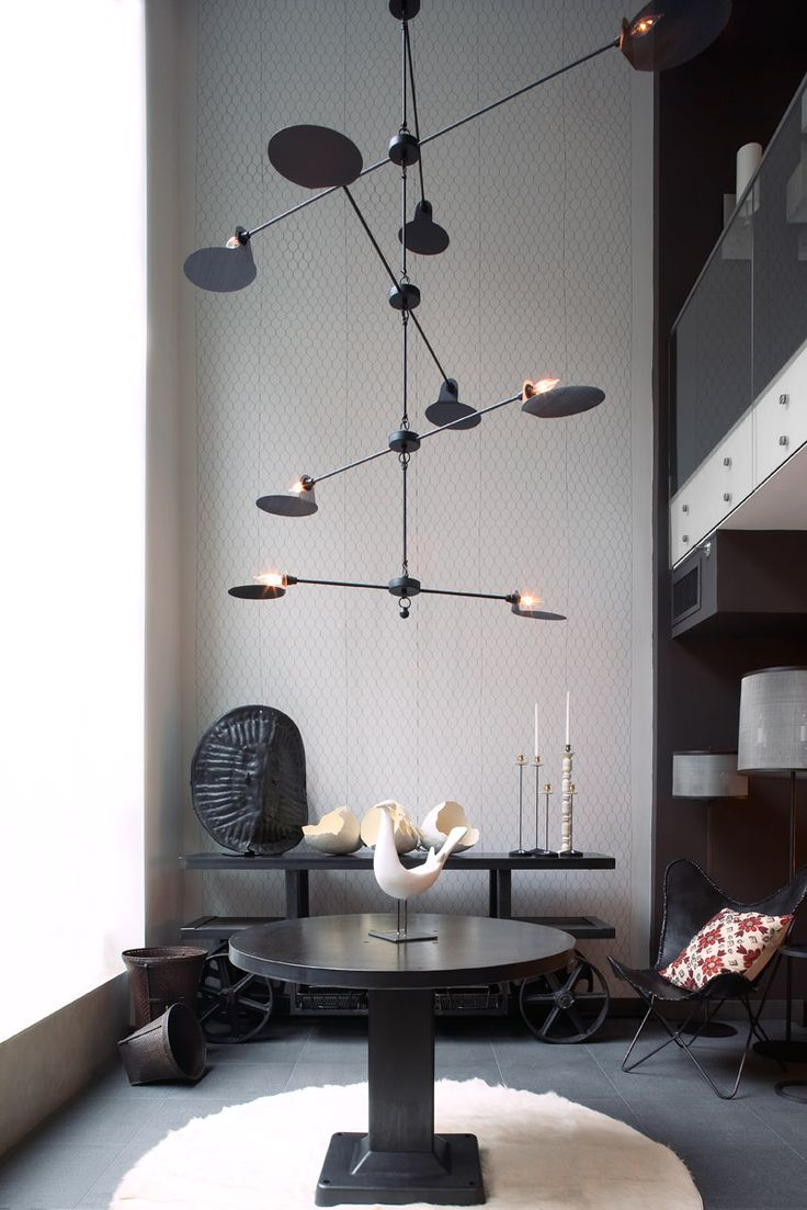 Grand eclectic Entrance with overscale Jose esteves Mobile chandelier and industrial console and table