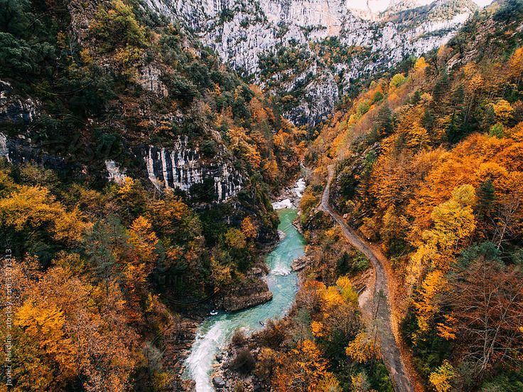 Aerial view of river and road on autumn by Javier Pardina for Stocksy United