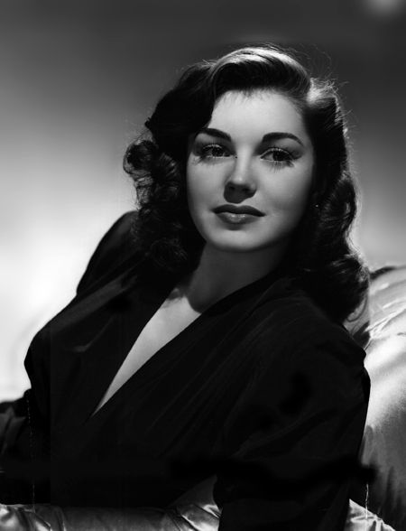 Esther Williams, a 1940's movie star who was a champion swimmer. Consequently, all of her movies feature her swimming. She has several of her own businesses, including her own fabulous swimwear line, and she even inspired the olympics to add synchronized swimming! I admire this woman.