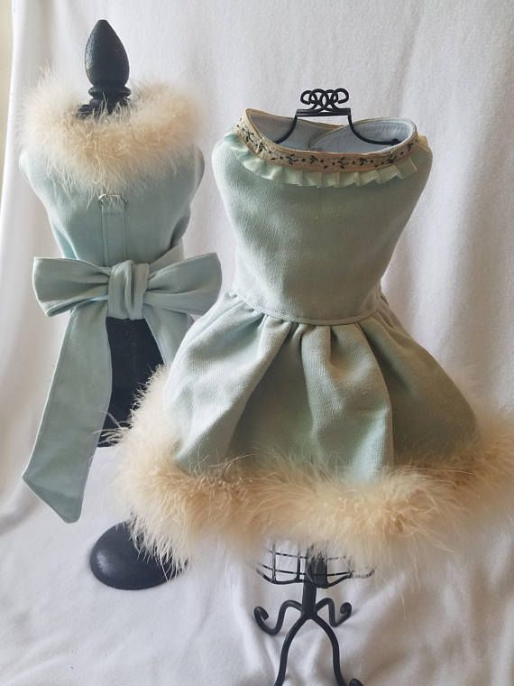 Aspen! Thats what were calling this absolutely stunning, light blue Belgian linen with ostrich feather trim dog outfit. The outfit includes a dress and coordinating jacket that can be worn together or alone giving you 3 total looks. Available in XXS - M. Dress: Velcro closure at neck &