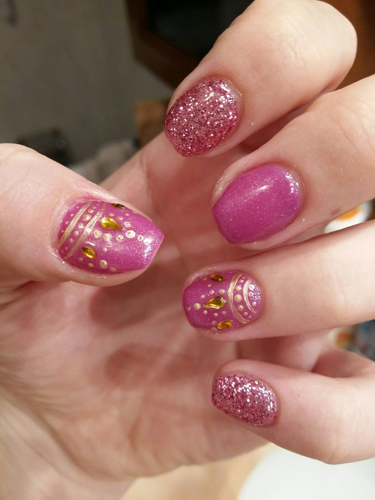 Purple gel nail with gold decorations