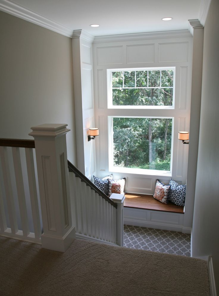 window seat on staircase with gorgeous molding