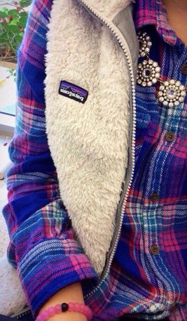 flannel + statement necklace + vest