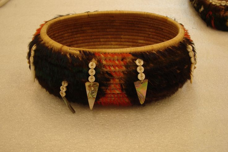 A beautiful basket with feather and shell embellishments. The basket was conserved by objects conservator, Gwen Spicer