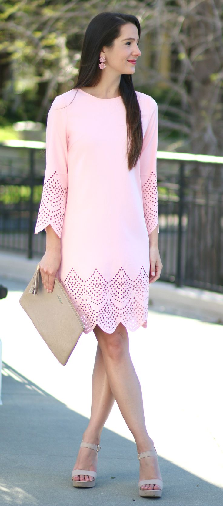 Pastel pink scalloped shift dress with hollow hem, pink cluster drop earrings, nude heels, and a nude GiGi New York Uber clutch. Simple spring wedding guest dress idea!
