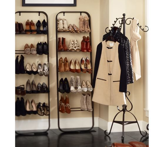 a pair of new york shoe ladders by pottery barn by a coat rack gives this space a boutique feel that could easily be duplicated with similar