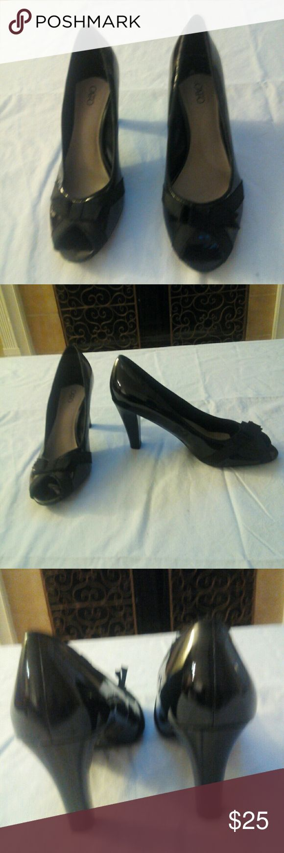 Peep toe pumps Black Patton leather peep toe pumps with a 3inch heel and a bow at the toe Cato Shoes Heels
