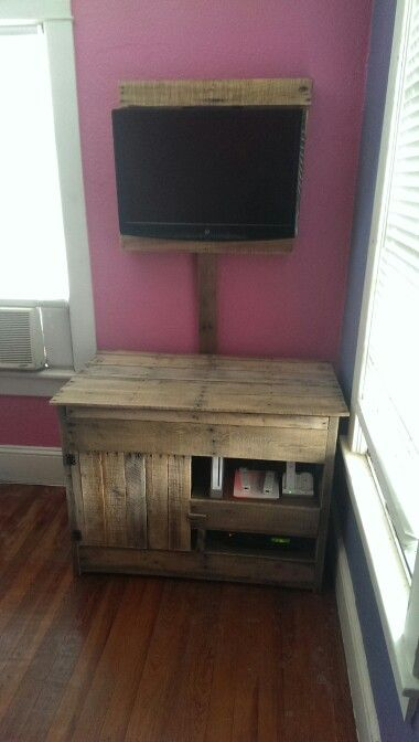 Pallet tv mount, cord cover, and media storage.  Top lid lifts for storage.  Bottom door opens for access.