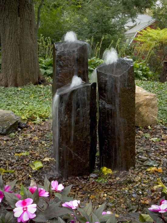 Basalt column fountains fit nicely into a natural landscape, attract birds  butterflies, plus it doesn't collect leaves.: