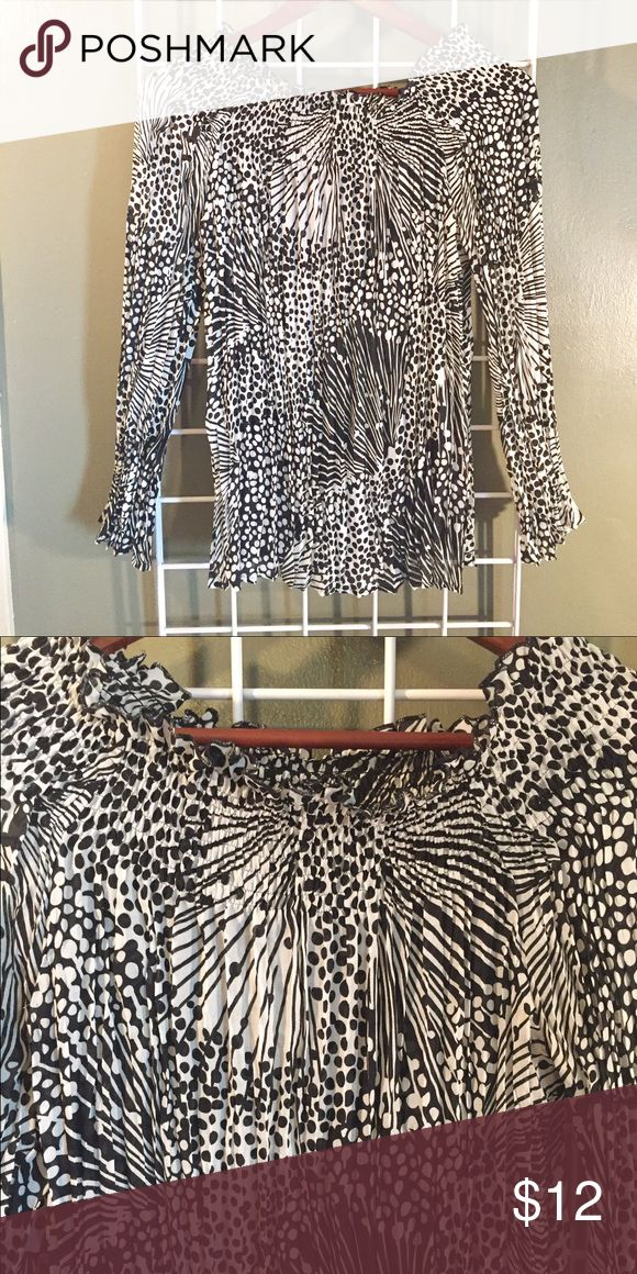 Women's chevron top Really cute black and white woman's chevron top. Bought from local boutique. Size medium. Tops