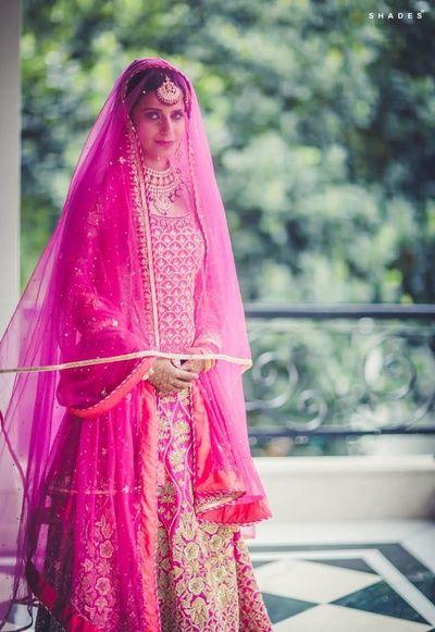 fuschia pink bridal outfit , floor length anarkali , sikh bridal outfit , raspberry pink bridal outfit , mithai pink bridal outfit , pink and gold , double dupatta , large veil on bride