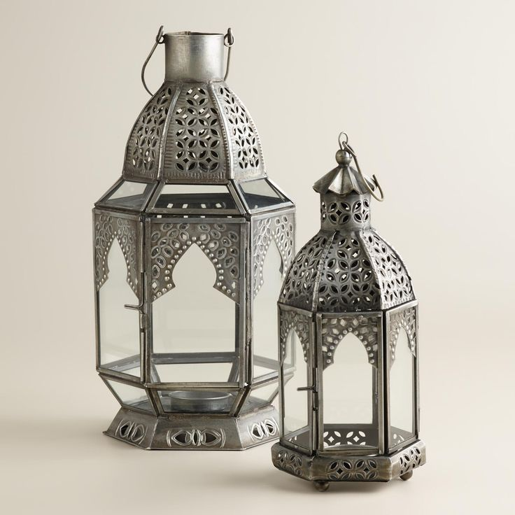 Cast a warm glow in your home with our Antiqued Zinc Latika Tabletop Lanterns. Beautifully handcrafted in India of glass and metal with antiqued finish, this exquisite lantern can be grouped in multiples for a chic and unique, affordable addition to your home décor. A single tealight placed inside makes it flicker to life.