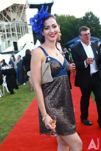Sybelle wearing a bespoke Natalie Chan couture millinery headpiece at the A #Highlight #event of the #racing calendar