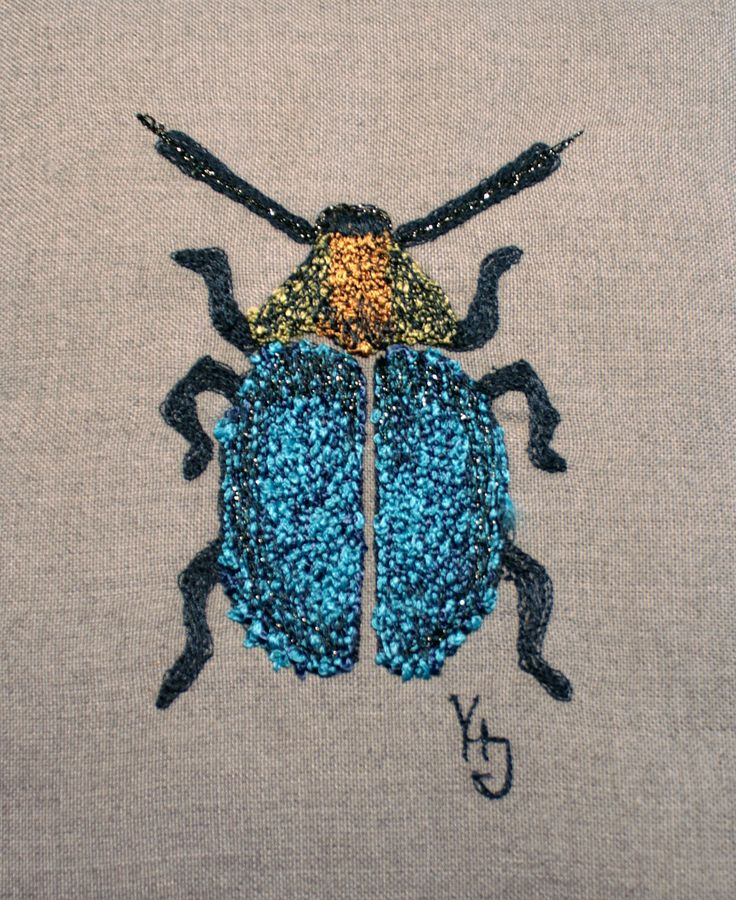 Free machine embroidery: a fat bug