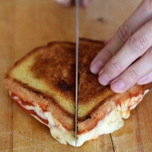 Cut it in half and get ready for the craziest cheese situation you ever did see. | This 5-Ingredient Pizza Grilled Cheese Is Unbelievably Delicious