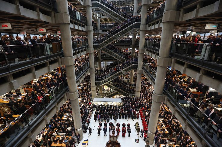 Brokers and underwriters line the balconies and escalators of the Lloyd's of London building during a service of Remembrance on November 11, 2015, in London, England. The annual Armistice Day service honors those who have lost their lives during times of war.