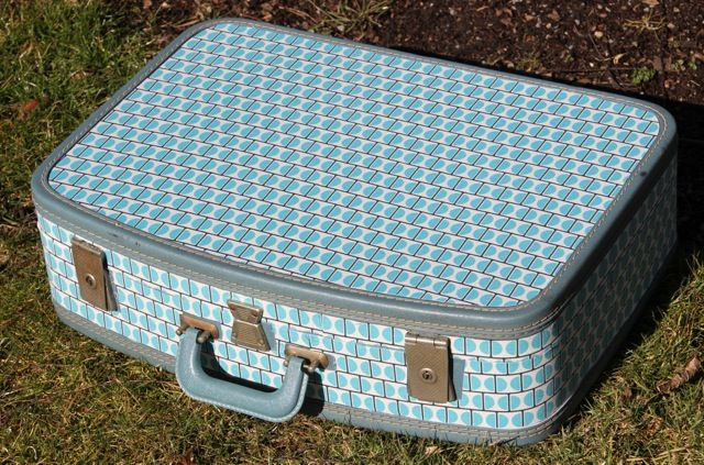 Fabric covered retro suitcase. Make a bunch and stack them for cute storage.
