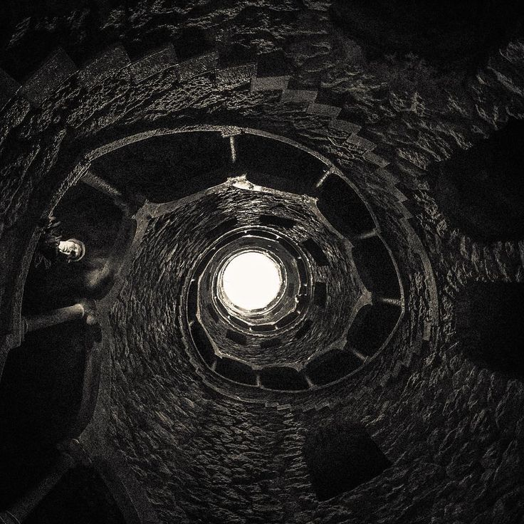 Initiatic Well - a subterranean tower that sinks 30 meters into earth made accessible by a monumental spiral stairway...