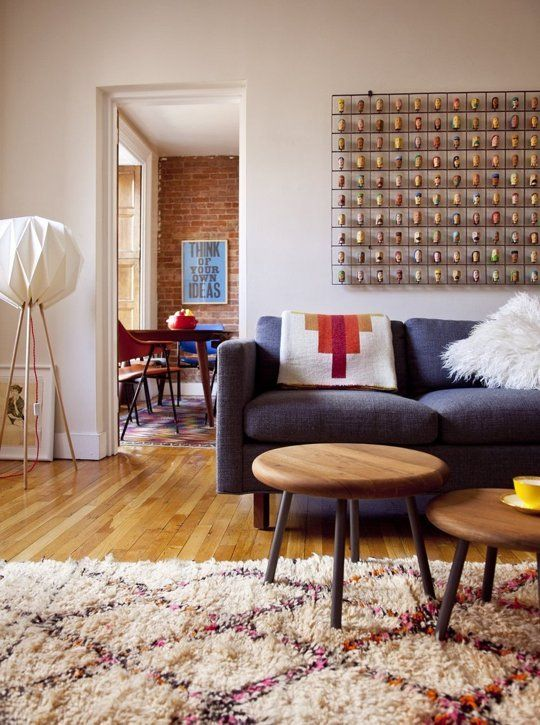 Don't Be a Square: Living Rooms Expertly Rocking Round Coffee Tables — Rooms That Get It Right   Apartment Therapy