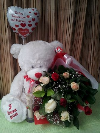 roses a balloon and soft toy.  What ever the size or value, we have something for everyone www.bloomsandgifts.com.au