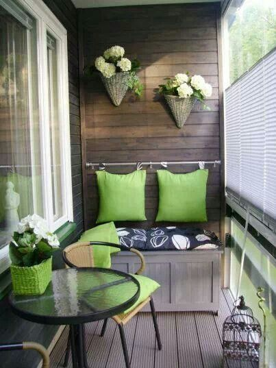 Wall decor for the balcony, and great idea, hang a curtain rood and slide the pillows on it!!!!