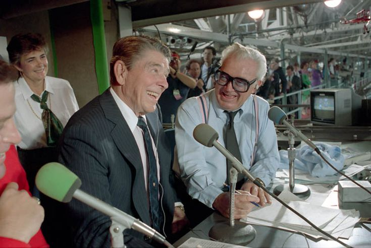 President Ronald Reagan in the press box with Harry Caray during a Chicago Cubs and Pittsburgh Pirates baseball game at Wrigley Field in Chicago. 9/30/88.