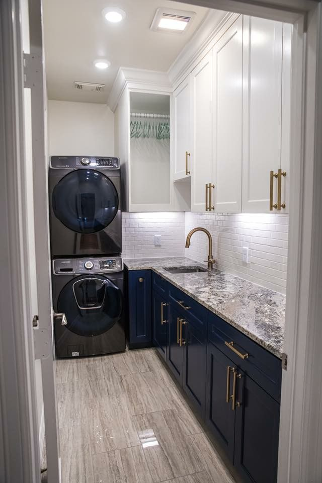 Elegant Laundry Room With Navy Blue And White Cabinetry