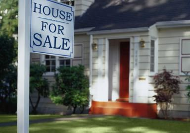 For Sale Sign in Front of a House - Ryan McVay/Photodisc/Getty Images
