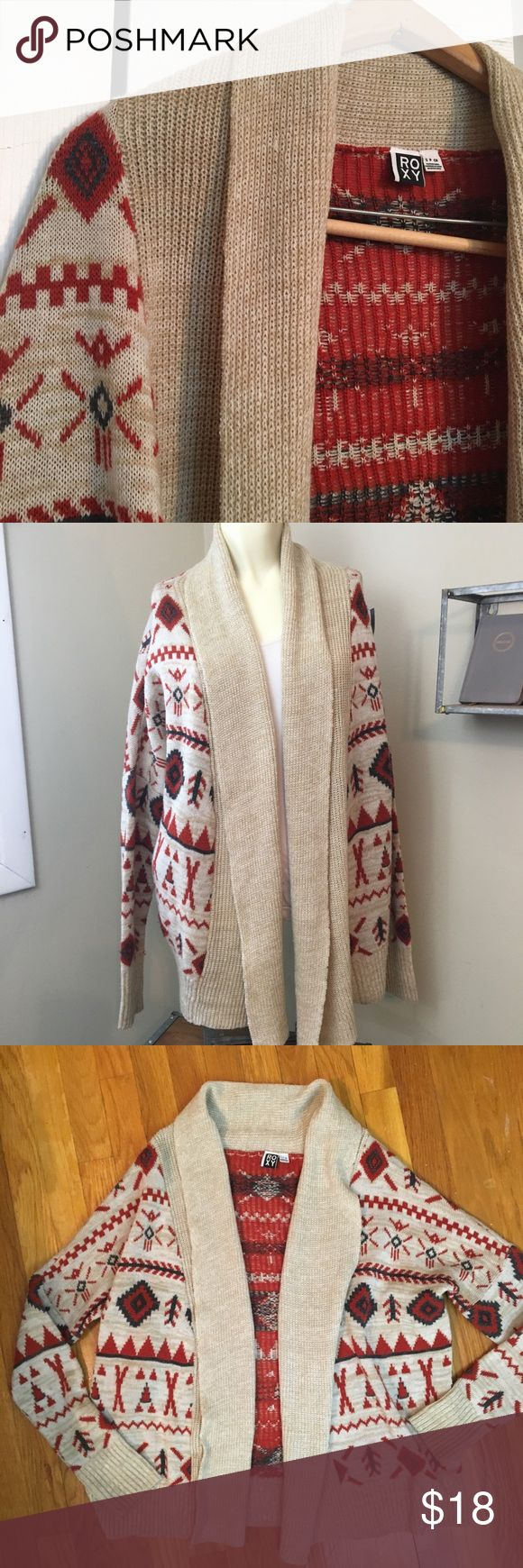 ROXY Tribal Print Cardigan Rust and gray colored designs on this tan cardigan. Aztec it tribal print. Open front. EUC. Tag says small but is oversized. I'd say Medium to even possible a large, depending on how you like the fit. Arms might be tighter but nothing crazy. Roxy Sweaters Cardigans
