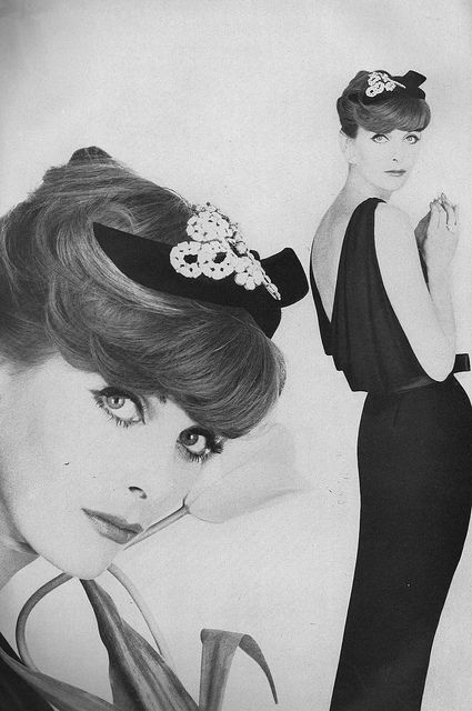July Vogue 1957 Anne St. Marie wearing a black crepé dress with a deeply cowed back that falls in 'V' folds, by Richard Cole.