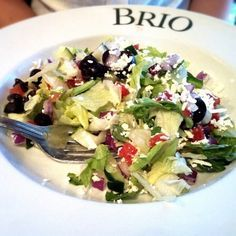 The Chopped Salad at Brio Tuscan Grille has chopped greens with tomatoes, olives, onions, cucumber, feta cheese with a red wine vinaigre...