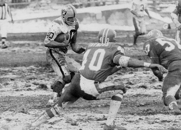 Oakland Raider Pete Banaszak battles the Denver Broncos for 11 yards in the third quarter in 1969. (Roy Williams/Bay Area News Group Archives)