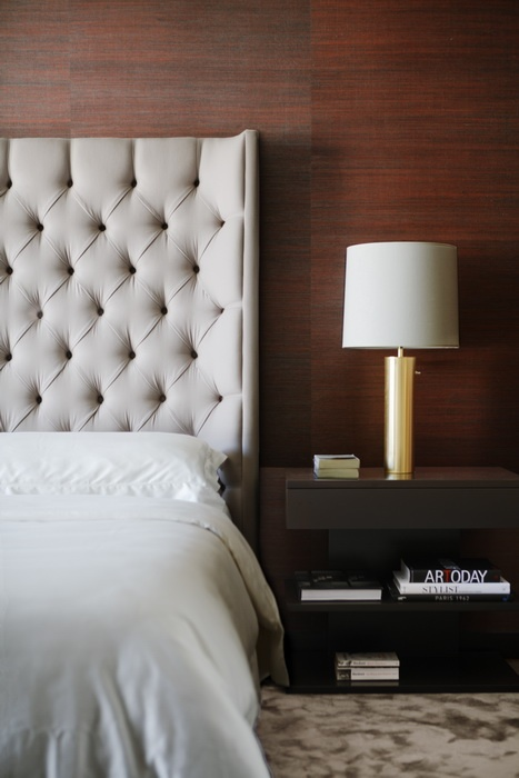 deep buttoned (tufted) headboard and contemporary hotel styling for the bedroom - Magdalena Keck Interior Design - Soho Flat