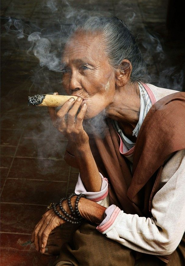 This smoking lady was sitting in a archway of a palace in the city of Mandalay in Myanmar // Photo and caption by Frans Alkemade for National Geographic