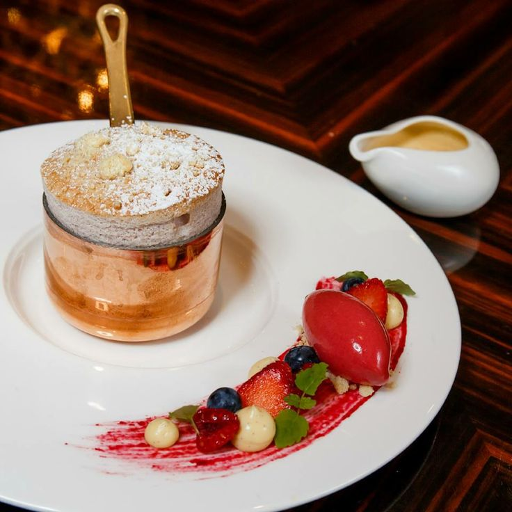 Berry Crumble Souffle with anglaise and berry sorbet.