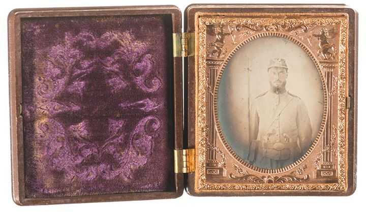 Lot 18: Portrait of an Armed Union Soldier Headline: Desirable Gutta Percha Cased Image of a Union Soldier Armed with a Rifle-Musket, Revolver, and a Smith & Wesson Volcanic Pistol sold for $2300  at the Rock Island September Premier Auction