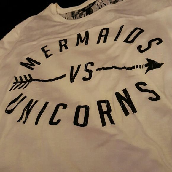 Seventeen Mermaids vs Unicorns Shirt This is a white lacey (back) unworn shirt from Seventeen. No flaws. Trades are accepted. Price is firm. Looks cute with leggings and is a Medium. Runs big and very comfortable. Seventeen Tops Tees - Short Sleeve
