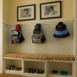 Organizing- add breadboard with chair rail and hooks to skinny wall for book bag storage!